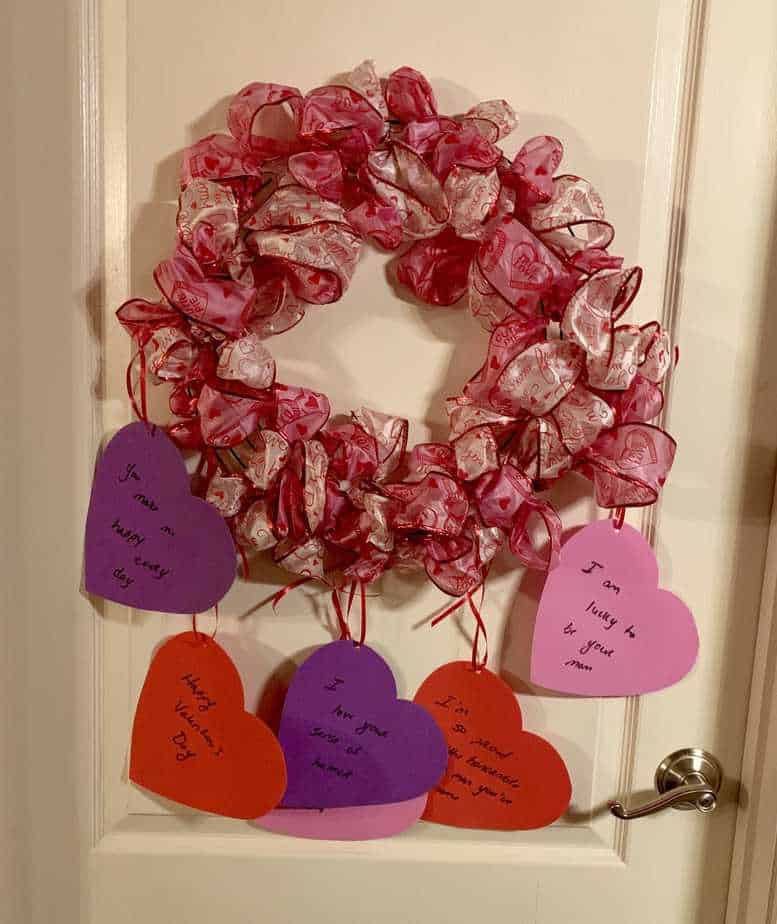 valentines day wreath with personalized notes on hearts