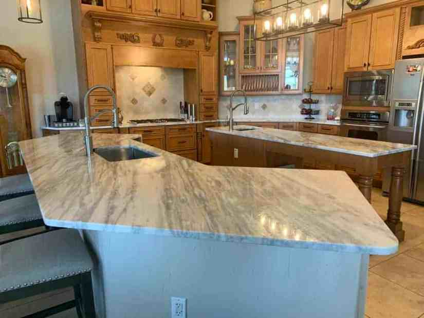 renovated kitchen with marble double islands