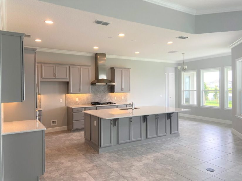 Gray and White Kitchen. Gray cabinets with white quartz countertops