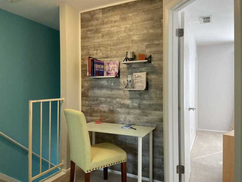 Gray vinyl plank accent wall and office nook