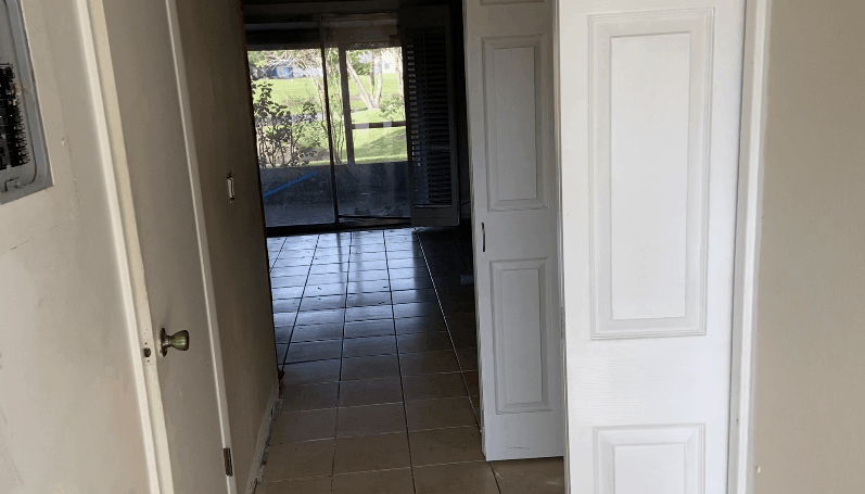 Dark entryway hallway perfect for wallpaper accent wall