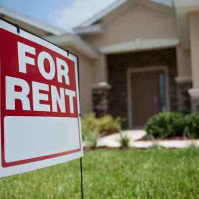 rental property with for rent sign
