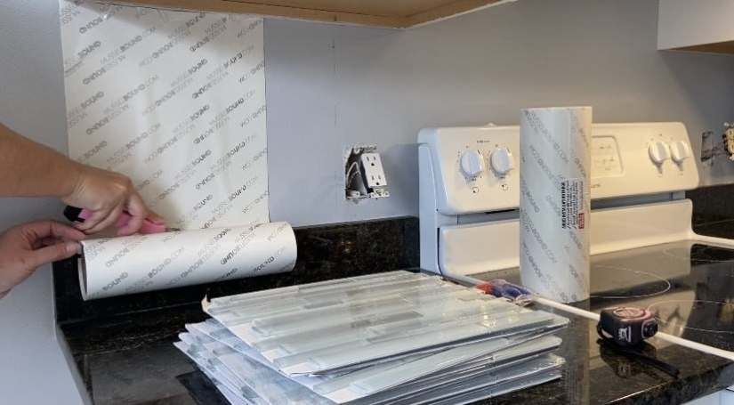 Install backsplash using adhesive tile mat. Unroll and cut with a straight edge