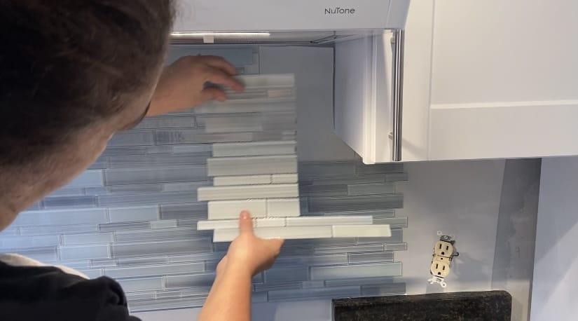 Blue glass tile on adhesive tile mat