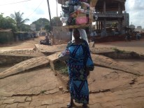 Togolese woman carrying her things