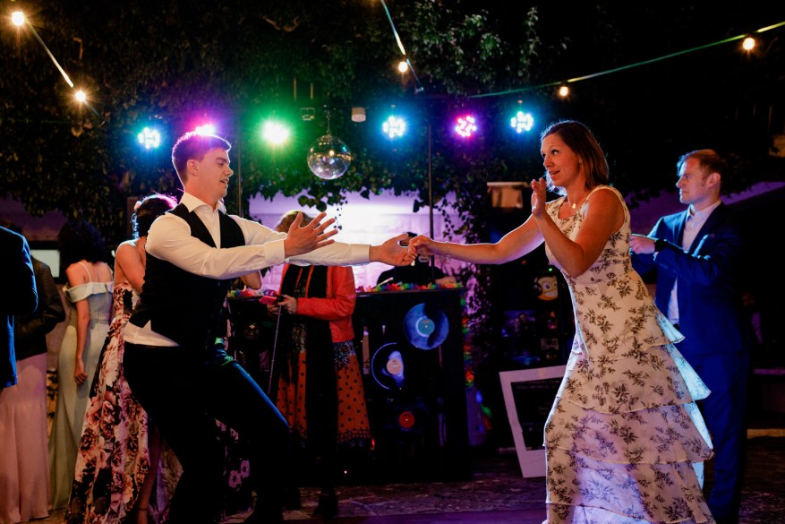 groom dances a tradicional swedish dance in his destination wedding in portugal