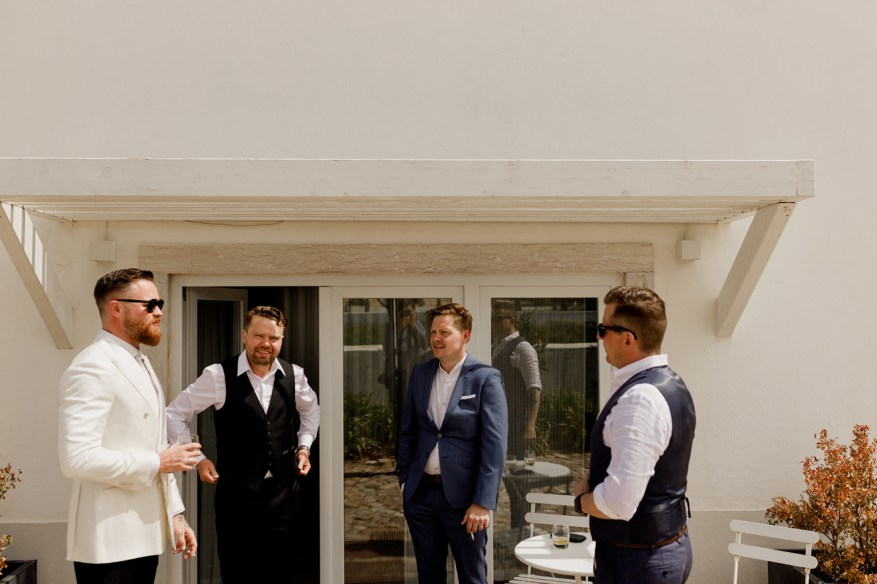 groom and wedding guests hanging out