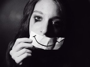 depressed girl with paper smile