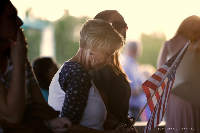 Image of People attending a prayer vigil held at Mountain Crest Park for the victims of Sunday night's shooting on October 3, 2017, in Las Vegas, Nevada.