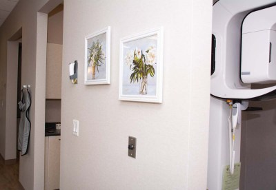 marcus dental back hallway to patient examination rooms wall with paintings - Tour The Office
