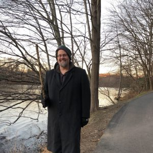 Marcus Chibucos Ph.D. walking by Lake Elkhorn, Columbia, Maryland