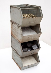Marcus Kleinfeld, COMMODITIES, 2011 Steel, ammunition, sand, coal, rice 77 x 25 x 38 cm