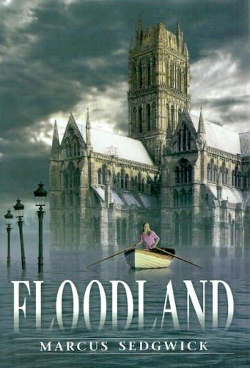US cover of Floodland, showing a girl rowing a boat with a sunken cathedral behind.