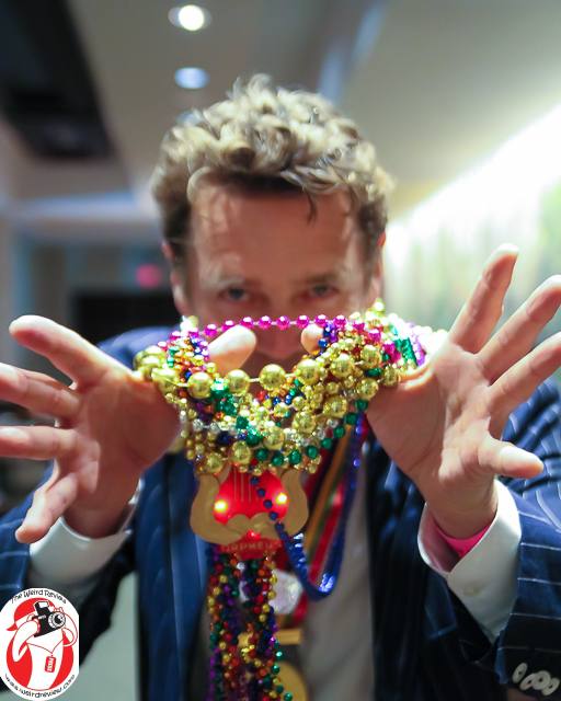 Who is the man behind the beads at the Orpheus Captains' Party?
