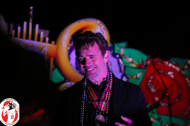 John Schneider smiles at celebrants as a Monarch of Orpheus