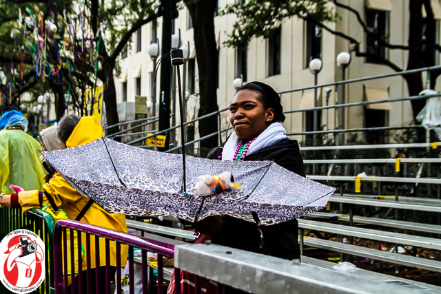 During the breaks in the rain, umbrellas were put to other purposes