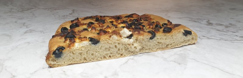 Goat cheese focaccia bread with sundried tomatoes and olives
