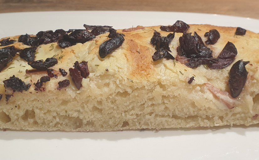 Delicious goat cheese focaccia with sundried tomatoes and olives