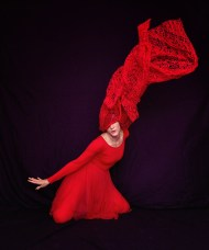 """Another from the first """"movement as art"""" set. On my head is a Red Riding Hood costume cape I picked up on sale at the grocery store. Started out with the typical jumping then got inspired to try pushing that cape to the limit to see what it could do. It did not survive."""