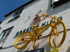 Yellow bikes: suspended from a pub...