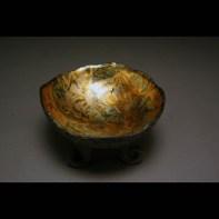 black three legged bowl