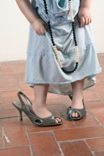 Young girl in older woman's shoes