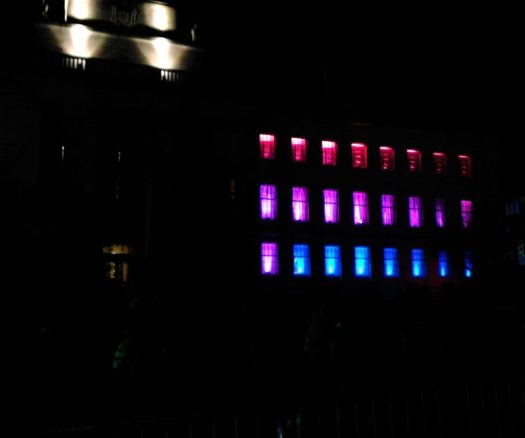 Barnsley Town Hall at night with red, purple and blue light installation