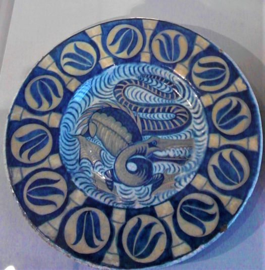 William de Morgan plate in blue and white with Medieval dragon motif , one of the mythical creatures at Cannon  Hall