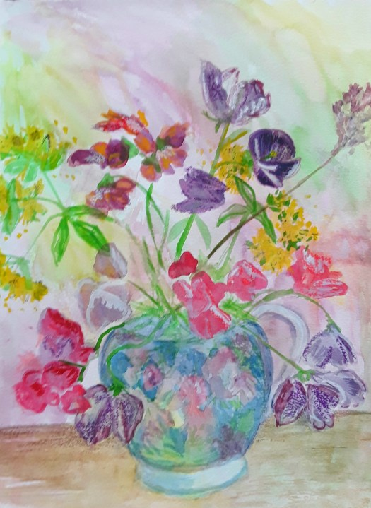 Sweetpeas and other watercolour flowers in a pretty china cup.