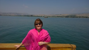 Me, standing on the bow of the boat. The scarf isn't vanity; it helps shield the skin from the sun.