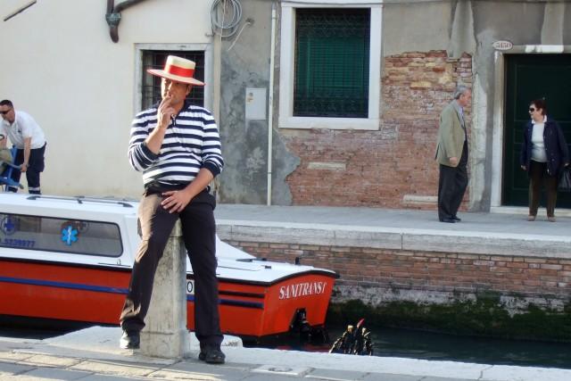 Venice gondolier taking a smoke break