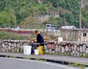Italian man making a broom by hand in Positano Photo by Margie Miklas