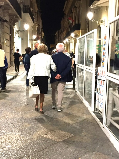 Older Sicilian couple in Trapani, Sicily photo by Margie Miklas