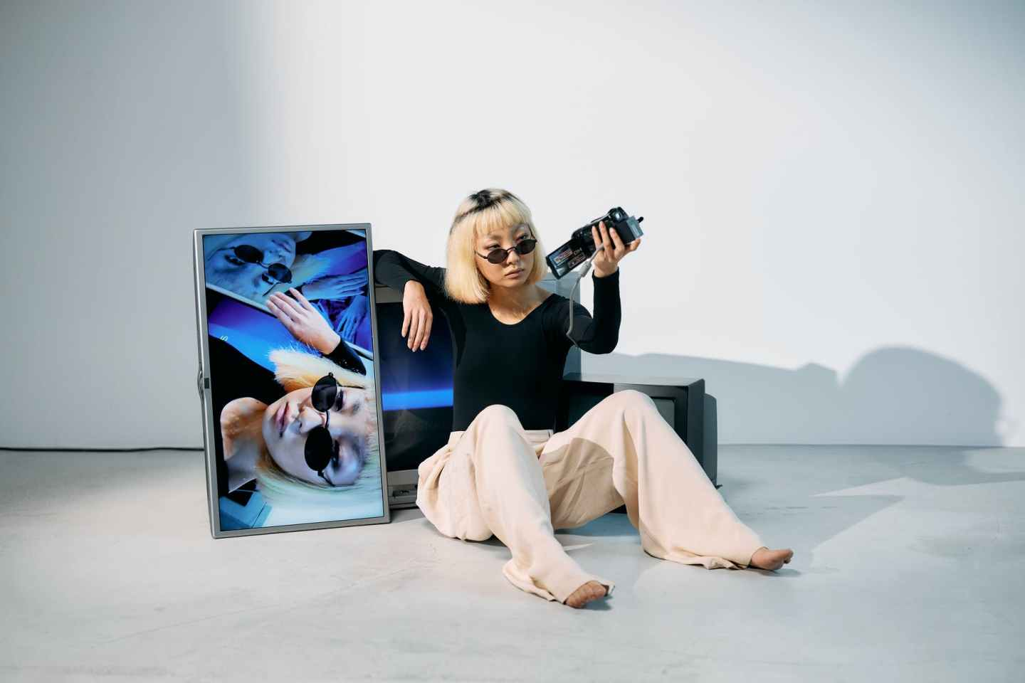 photo of woman holding video camera