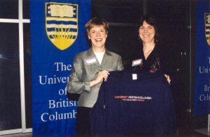 Margo presenting a coveted Trek Program t-shirt to Martha Piper