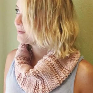 image of woman wearing a knitted cowl