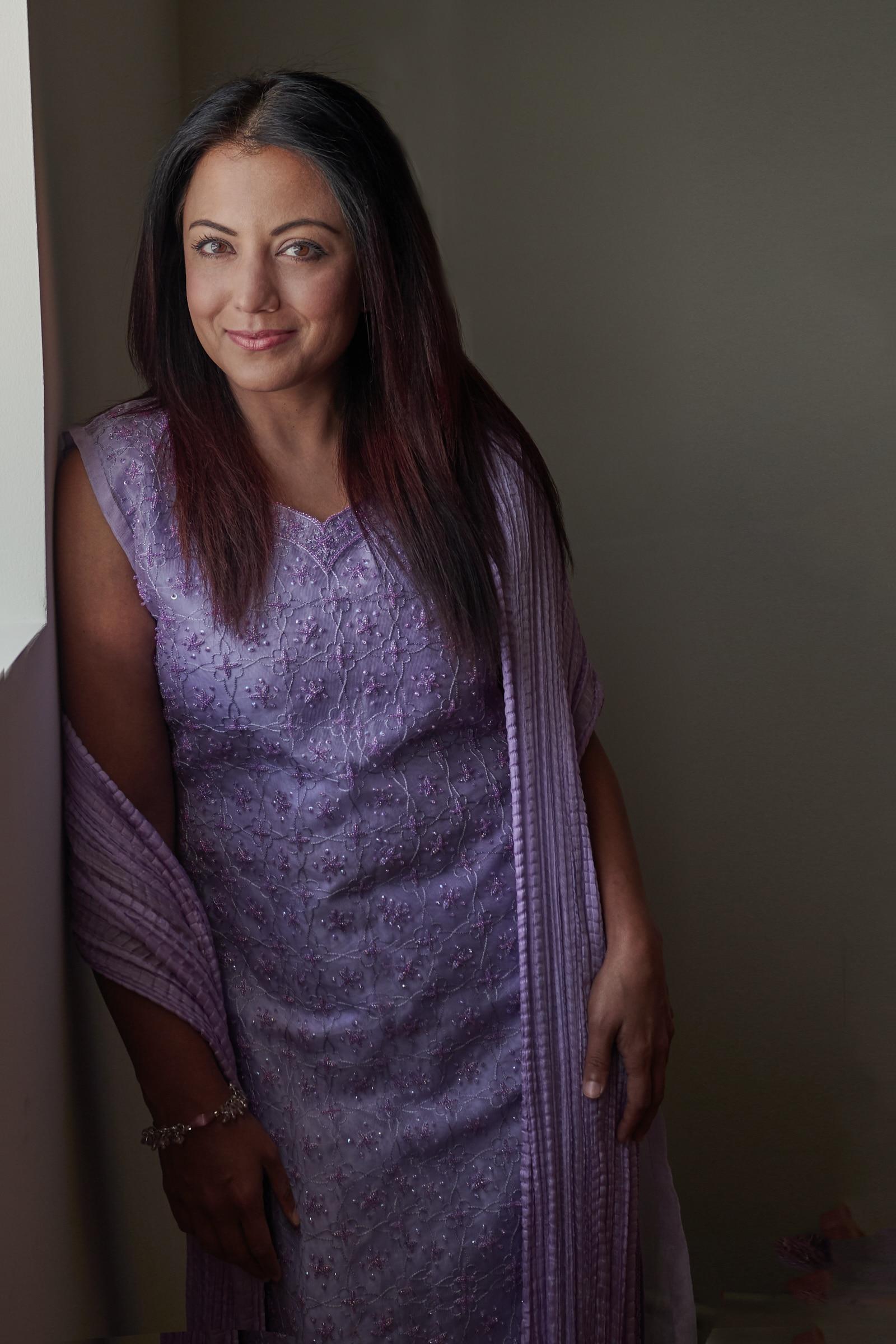 wall pose purple dress