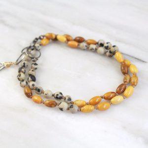 Kusini Knotted Dalmatian Jasper and Ivory Jade Bracelet by Sarah Deangelo