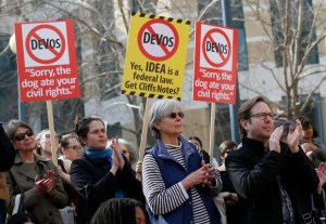 Protesters applaud at a noon rally at the The Ronald V. Dellums Federal Building in Oakland, Calif., on Tuesday, Jan. 31, 2017. Nearly 1,000 people denounced the appointment of Betsy DeVos as Secretary of Education after a Senate committee advanced her nomination. (Jane Tyska/Bay Area News Group)