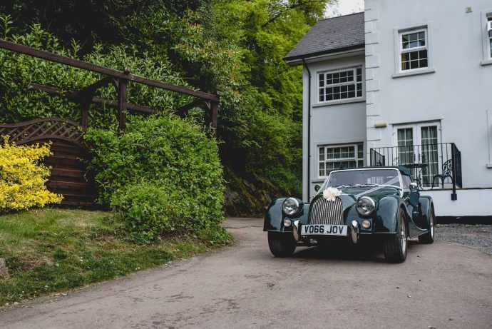 Hatty's dad's vintage Morgan waits to drive her to her quirky Birtsmorton Court wedding