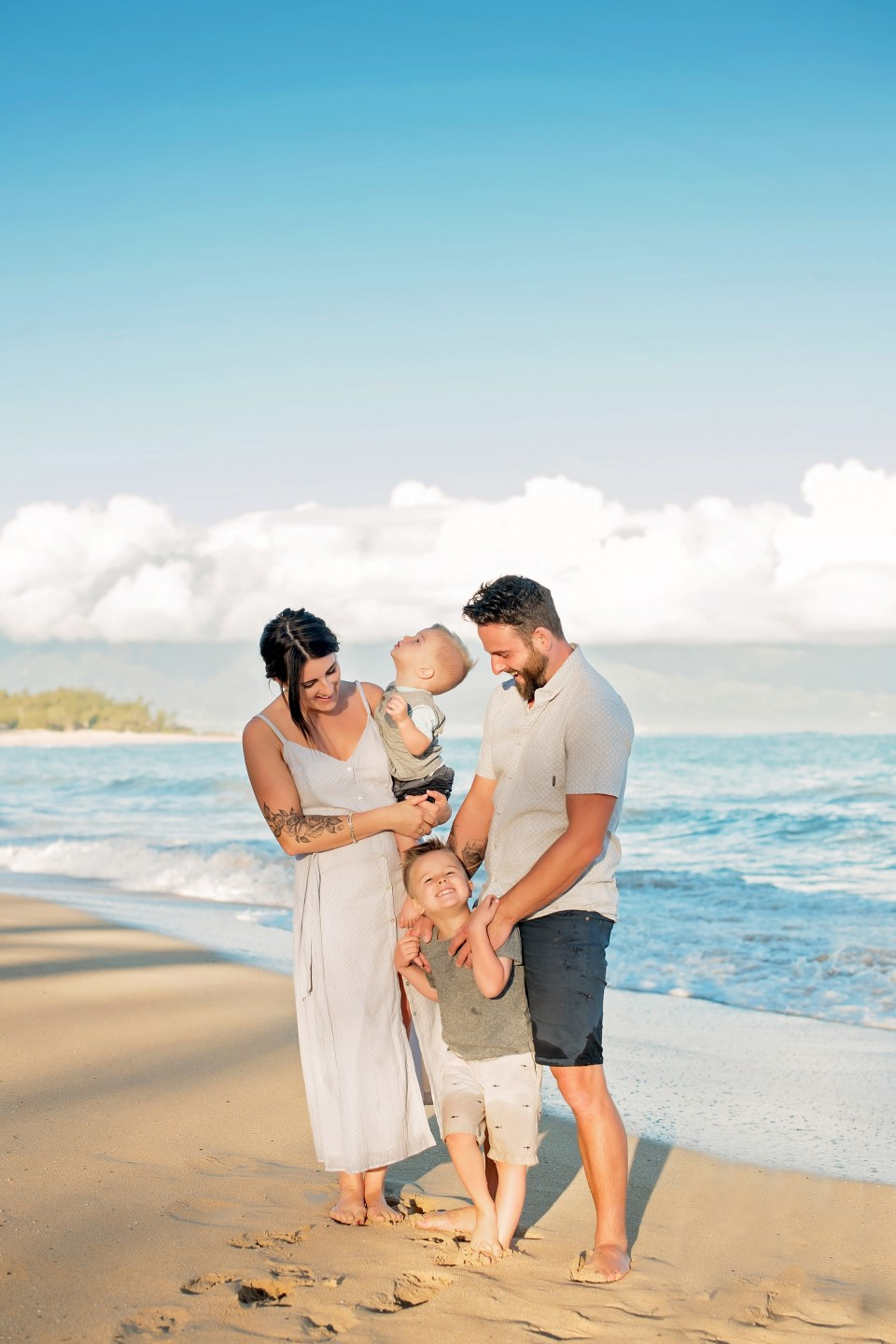 Beautiful family session at dawn at Baldwin Beach in Paia, Maui