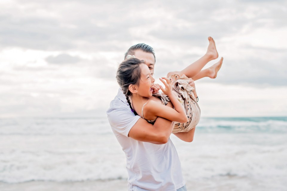 Sunset family session at Maluaka Beach in Makena, Maui on a high tide, stormy evening by Maui photographer Mariah Milan