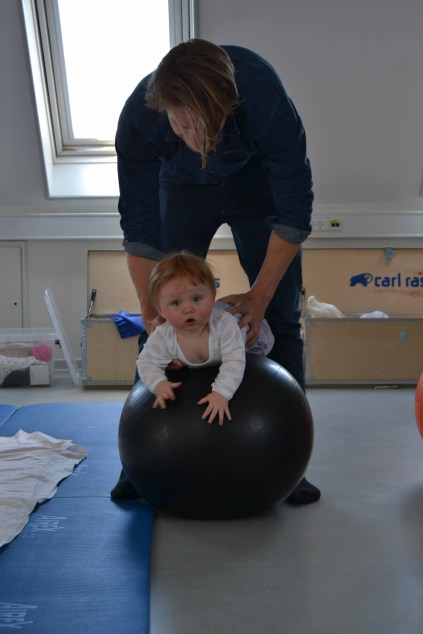 Father & Baby exercise on a core ball