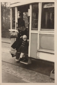 A boy and his mother at a tram in Copenhagen