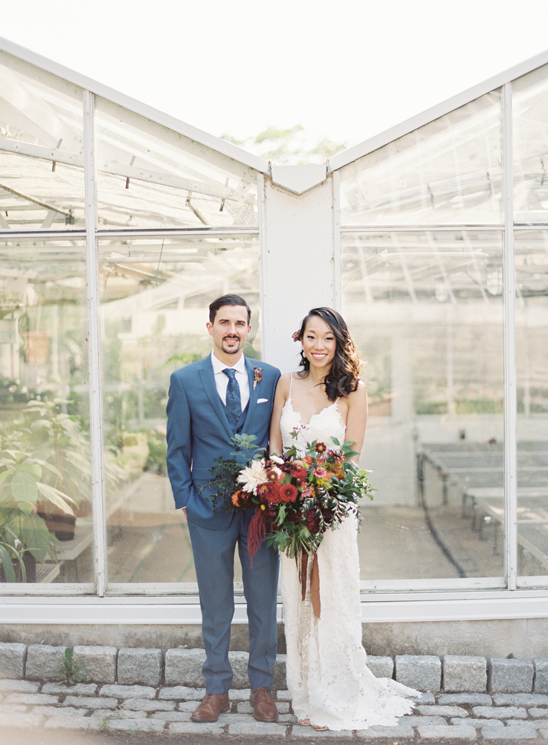 Morris Arboretum wedding photo of bride and groom in front of greenhouse