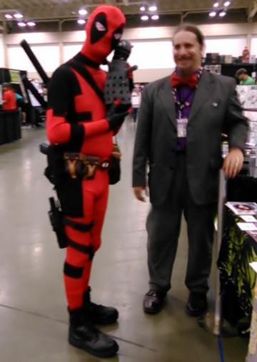Deadpool poses with John Cowgell and John's squishy Dalek.