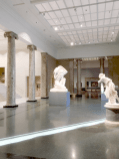 Ionic columns mark the passage from the statues (old lobby) to galleries.