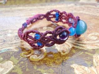 Macramé bracelet with blue and violet beads