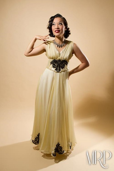 Marianne Cheesecake strikes a pose for the camera in her classic vintage dress