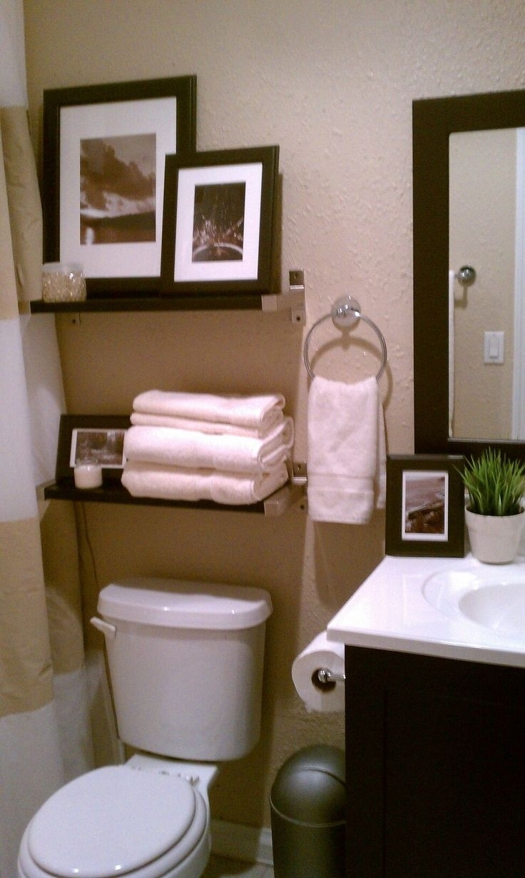 small bathroom- decorative storage above toulet #bathroom intended for Decorating The Bathroom
